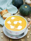 Pumpkin soup with sour cream Stock Images