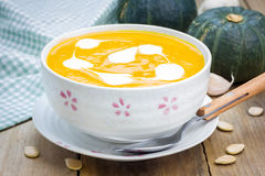 Pumpkin soup with sour cream Royalty Free Stock Image
