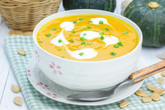 Pumpkin soup with sour cream Royalty Free Stock Photos