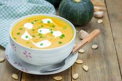 Pumpkin soup with sour cream Stock Photos