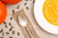 Pumpkin soup with spoon Stock Image