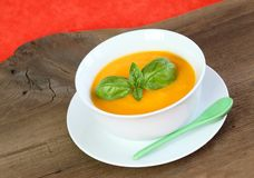 Pumpkin soup and  sweet basil Royalty Free Stock Image