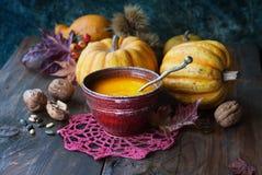 Pumpkin soup on table Stock Photo