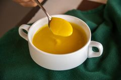 Pumpkin soup on the table royalty free stock photo