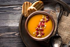 Pumpkin soup. And toast of white bread, top view stock photography