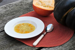 Pumpkin soup. Pumpkin soup with two large pumpkins in the background Stock Images