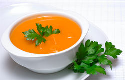 Pumpkin soup in white bowl Stock Image