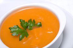 Pumpkin soup in white bowl Stock Photo