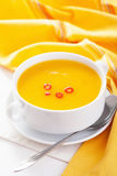 Pumpkin soup in white bowl Stock Images