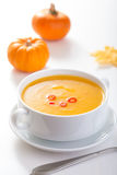Pumpkin soup in white bowl Royalty Free Stock Images