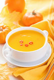 Pumpkin soup in white bowl Stock Photography