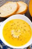 Pumpkin soup in white bowl Royalty Free Stock Photo