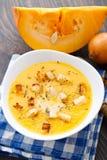 Pumpkin soup in white bowl Royalty Free Stock Photos