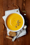 Pumpkin soup in white bowl Stock Photos