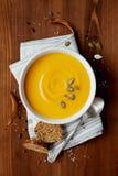 Pumpkin soup in white bowl Stock Photos
