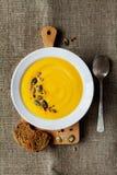 Pumpkin soup in white bowl Stock Photo