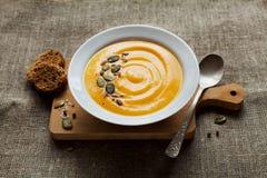 Pumpkin soup in white bowl Royalty Free Stock Image