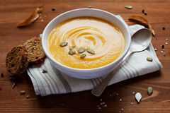 Pumpkin soup in white bowl Royalty Free Stock Image