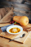 Pumpkin soup in white bowl, dietary vegetable Royalty Free Stock Photo