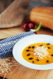 Pumpkin soup in white bowl, dietary vegetable Stock Photos