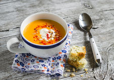 Pumpkin soup in white ceramic Cup and a piece of cake with cheese and herbs Royalty Free Stock Image