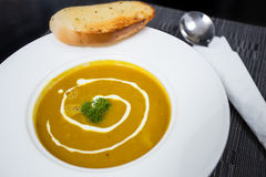 Pumpkin soup. In white dish with sliced bread Royalty Free Stock Image