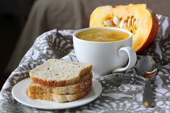 Pumpkin soup in white mug on table. Stock Photography