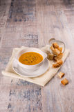 Pumpkin soup in a white plate Royalty Free Stock Image