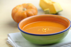 Pumpkin soup. A wholesome vegetarian soup with whole pumpkin Stock Photo