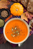 Pumpkin soup in wooden bowl, vertical Royalty Free Stock Image