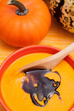 Pumpkin soup with wooden spoon Royalty Free Stock Photo