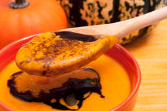 Pumpkin soup on a wooden spoon Stock Photo
