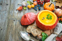 Pumpkin soup on a wooden table Royalty Free Stock Photos