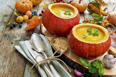 Pumpkin soup on a wooden table Royalty Free Stock Images