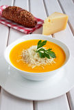 Pumpkin soup on a wooden table Stock Photo