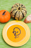 Pumpkin soup in a yellow plate Stock Photography