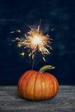 Pumpkin and sparkler Stock Photos