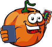 Pumpkin speaking on a smartphone while reading a tablet Stock Images