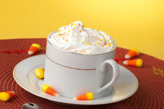 Pumpkin Spice Coffee. Close up of cup of fresh, delicious Pumpkin Spice Coffee, and candy corn Royalty Free Stock Image