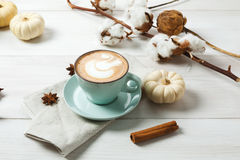 Pumpkin spice latte. Coffee cup on white wood background Royalty Free Stock Image