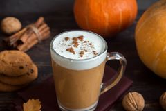 Pumpkin Spice Latte. Cup of Latte with Seasonal Autumn Spices, Cookies and Fall Decor. Traditional Coffee Drink for Autumn Holidays stock photography