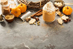 Pumpkin spice latte in a glass mug Royalty Free Stock Photos