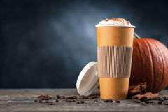 Pumpkin spice latte in a paper cup Royalty Free Stock Image