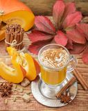 Pumpkin spice latte smoothie with whipped cream Royalty Free Stock Image