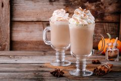 Pumpkin spice latte with whipped cream and cinnamon stock photography
