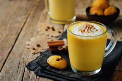 Pumpkin spice latte with whipped cream and pumpkin chocolate chi Stock Photo