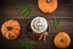Pumpkin spice latte. With whipped cream on wooden background, top view Royalty Free Stock Photography
