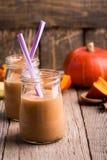 Pumpkin smoothie with yoghurt and bananas Stock Photos