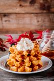 Pumpkin spice waffles with whipped cream for Thanksgiving Day. stock images