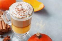 Pumpkin spiced latte or coffee in glass. Autumn, fall or winter hot drink. Stock Image